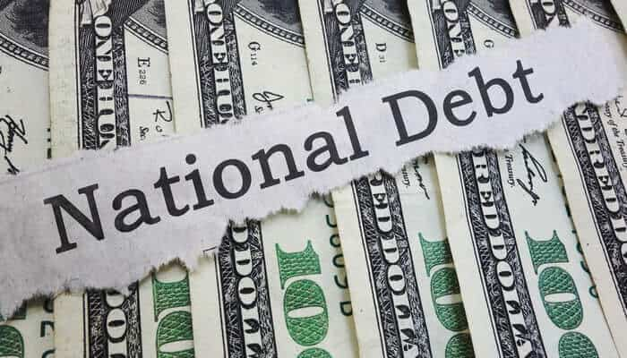 national bebt headline on cash