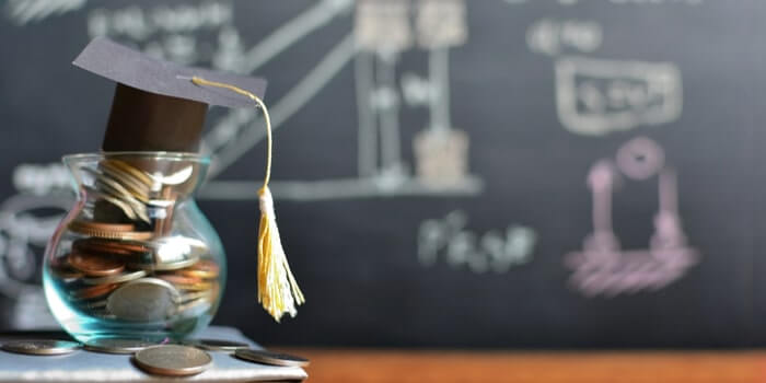 graduation hat on coins saving